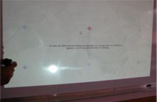 Le point chaud reflété par le vidéoprojecteur au tableau blanc gêne